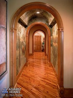 Arched and Painted Corridor at The Lodge by Custom Home Builder Tampa Alvarez Homes - (813) 701-3299 http://www.alvarezhomes.com/tampa-home-builders-portfolio-of-homes/the-lodge