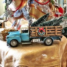 Old Stake Bed truck model with Christmas trees -- McIntosh Nesbit<br> Christmas Red Truck, Ribbon On Christmas Tree, Christmas Porch, Rustic Christmas, Winter Christmas, Vintage Christmas, Christmas Ornaments, Christmas Stuff, Christmas Time