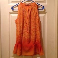 Tahari Orange Blouse Like new, barely worn. A great pop of color! Four hidden snaps close the front of the blouse. Stretches at the bottom with elastic Tahari Tops Blouses