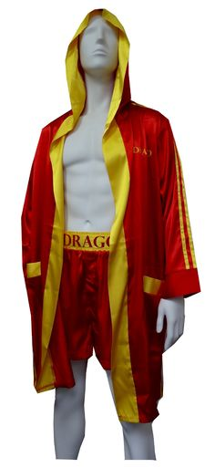 Ivan Drago Satin Boxers with Hooded Satin Robe  I must break you. If you loved Ivan Drago in Rocky IV, now is your chance to look like him (minus the bad attitude!). This soft satin set includes boxer shorts fashioned like those worn by Drago, complete with the wide waistband (button fly), with the Soviet Hammer and Sickle and Drago on the waist. Boxers fit size small through large. The coordinating robe completes the warm-up look, with a hood and exterior belt with the Soviet logo  $45