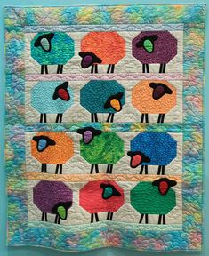 """Wall Quilt 12, """"Baa, Baa"""" by Roberta Granville  """"The sheep pattern reminded me of recent trips to New Zealand, which has over 20 million sheep, as well as to Ireland, where sheep are also plentiful. It is a colorful, fun quilt to make."""" Baa Baa, New Zealand Travel, Capital City, Quilt Making, Sheep, Ireland, Trips, Kids Rugs, Colorful"""