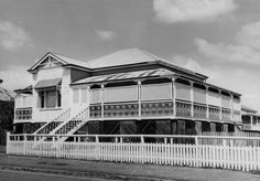 """Australia: Queenslander buildings are primarily of timber construction and can be low or high-set, one to two storeys. They are typically """"tripartite"""" in sectional composition; underfloor (stumps), primary rooms (can be two levels), and roof. All have one or more veranda spaces, a sheltered edge of the building that is typically only part-enclosed and used as another living zone. This consideration for climate is the defining characteristic of the Queenslander type."""