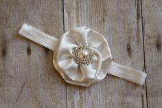 Ivory Satin Flower Headband - Baptism Headband - Christening - Baby Girl Flower Headband - Flower Girl Headband. $12.95, via Etsy.