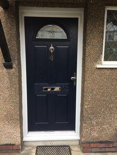 Launa Windows - Brislington, Bristol Dark Blue Composite Door with 4 panels and arched window featuring Zinc Art Elegance design, and chrome furnishings
