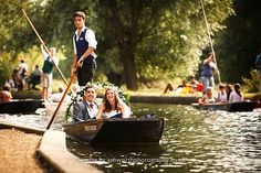 Wedding couple punting on the river to Doubletree Hilton Cambridge