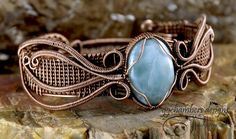 This is the first antiqued copper wire cuff style bracelet in my Princess Series. This bracelet features a stunning gem grade Larimar cabochon from the Dominican Republic, where it is mined. This b…