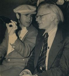 Singer Elton John chats with artist Andy Warhol during a private party at the Xenon disco in New York on June 13, 1978. (Associated Press / News-Tribune file photo)