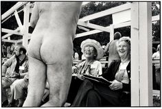 "Bakersfield, California, 1983 © Elliott Erwitt ""The picture of the nudist contestant trying to influence the judges in a contest for Mr. Nude California was taken in Bakersfield, California. He did not win."""