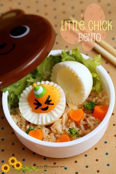Little Chick Bento is made from Garlic fried rice, lettuce leaf, hard boiled egg, nori, blanched carrots and cauliflower.