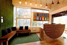 Digital Nest - The reception desk resembling a nest and the faux grass wall welcoming into the cozy space Faux Grass, Workspace Design, Office Interiors, Nest, Reception, Layout, Cozy, Urban, Digital