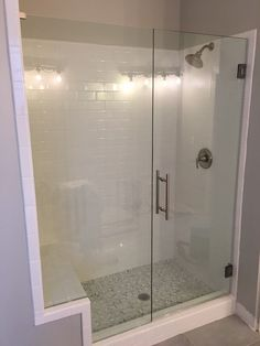 Inline frameless shower with stationary notched panel, door that swings in and out, Brushed Nickel Ladder Pull handle and hardware