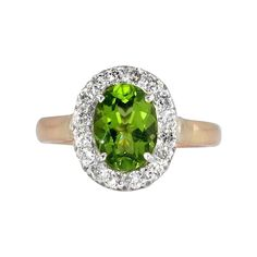 This lovely authentic vintage peridot and diamond halo ring has romantic undercarriage work, glittering diamonds, and a newly polished 7.5x6mm oval -- found at www.rubylane.com #VintageBeginsHere @rubylanecom