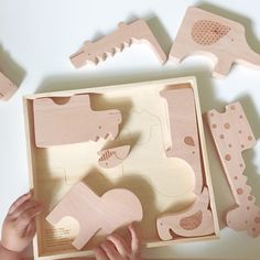 Wooden safari animals toys: puzzle, stack and display.