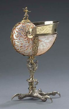 Nautilus Cup: Hunter and Eagle's Claw Foot  around 1580-1610  Goldsmith: Southern Germany  Shell: China (?)  nautilus shell, gilded silver  33.2 x 12.7 x 18.0 cm  The Thomson Collection © Art Gallery of Ontario