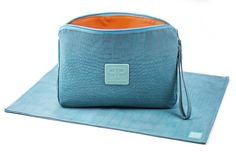 The Turquoise Diaper Clutch combo from Posh Play is an eco-friendly, portable diaper clutch and changing pad combo made of PVC free faux leather. Retail price is $58.