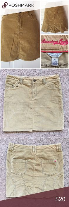 "American Eagle Stretchy Tan Velvet Skirt American Eagle Outfitters  Stretchy Velvet Skirt Tan/ beige/ ""khaki"" colored Women's Size 6 ""stretchy"" listed on tag 97% cotton / 3% spandex Pink signature American Eagle logo small on back pocket Measurements [flat & unstretched]: 16"" width [across top] 17"" length [top to bottom] American Eagle Outfitters Skirts"