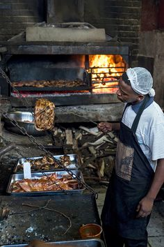 At Mzoli's, meat is cooked quickly over eight roaring braais. (Photo: Joao Silva/The New York Times)
