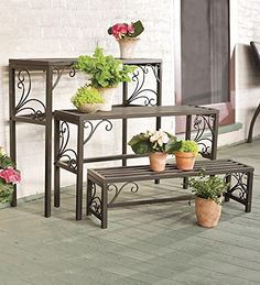 Set of Three Nesting Plant Stands With Scrollwork Plow & Hearth http://smile.amazon.com/dp/B00CBHQP18/ref=cm_sw_r_pi_dp_WRSavb07HSHG5