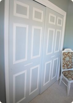 What a genius idea for making those boring white sliding closet doors actually look sophisticated!