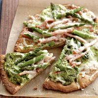 Naan pizza with pesto, asparagus, and ricotta. (use cauliflower crust)