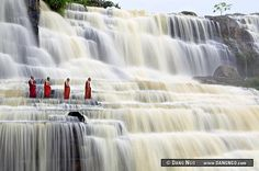 Amazing Grace - Buddhist monks chant at Pongour Falls, the largest waterfall in Dalat, Vietnam.