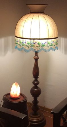 My most prized find in a shop in Tuscany. Solid wood base with a silk shade. The stained and discolored shade was beautifully shaped with an amazing glass bead pattern. I found an artisan in Arezzo who redid the shade and it turned out beautifully. I wish this lamp could talk so I could know more about its history.