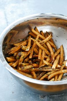The secret to crispy homemade french fries? Double frying. Toss with fresh garlic, dill, and sea salt for extra flavor!