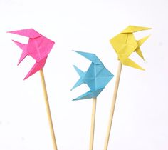Neon origami fishes - pink turquoise yellow - set of three pin. €6.00, via Etsy.