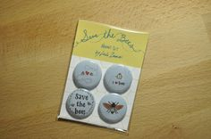 One set contains four lovely Save the Bee illustrated buttons or magnets. Show your bee support with these four happy and vibrant one-inch buttons. Arrives carefully packaged in custom sealed cello wrap and colorful card stock backing. These lovely sets are printed on archival paper with archival inks. Magnets: Each magnet can hold 6 letter sized sheets of normal copy paper. The magnet is encased within a metal jacket and causes no black smudges on surfaces.