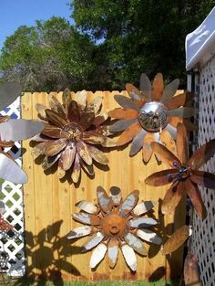 Sunflowers from old fans and hubcaps