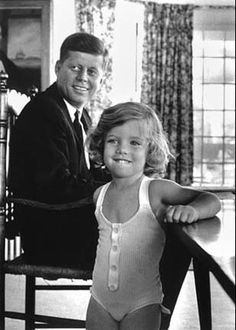 John F. Kennedy and his daughter, Caroline, at home in Hyannisport, Massachusetts, 1960.