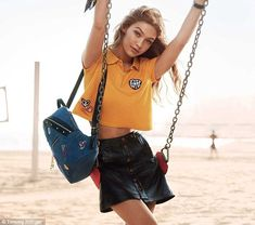 Gym bunny:In further shots, the LA native posed in a mustard cropped polo shirt and high-waisted leather skirt, which flashed her toned midriff