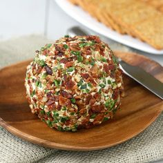 This Bacon Jalapeño Cheese Ball recipe will be the star of your next party. It's spicy, so watch out! It'll be gone in no time. Serve with crackers.