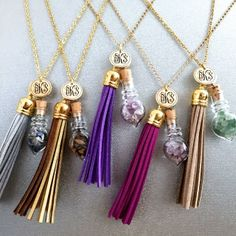 """Silver tassel and Flourite - filled shaped glass cork vial on a 30"""" gold plated chain."""