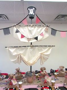 Pirate themed birthday party. Impressive ship's mast centerpiece! Perfect for a pirate party.