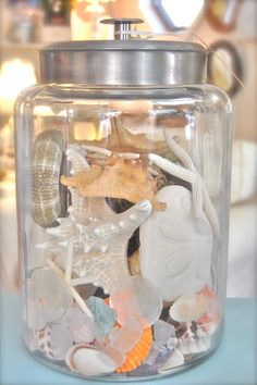 Shells....we have tons from the Outer Banks.  This is going to happen for sure.  I put mine in Mason Jars and they are so pretty.
