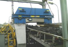 A large Electro Overband Magnet removing tramp ferrous metal from conveyed #coal #Mining Coal Mining, Bunting, Magnets, The Unit, Metal, Garlands, Buntings, Metals, Banting