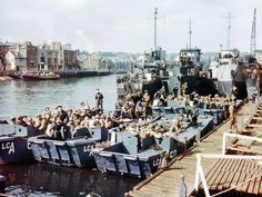 """Weymouth june 5, 1944.   5th Ranger Battalion. The first two boats, from left, are 'A' Co. The man in the furthest left boat with the helmet net on, toward the front of the photo, is 1 Lt. Charles """"Ace"""" Parker, A/5 Company Commander."""