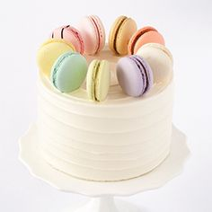 Happy Canada Day! While our stores are closed as we celebrate with our families, here is some eye candy for you. This macaron adorned cake combines two of the things that Bobbette & Belle does best, cake and French macarons! It features textured vanilla buttercream in a swirl pattern on the outside of the cake and a ring of our famous French macarons all around the outer edge of the top of the cake. #bobbetteandbelle #toronto #bakery #cake