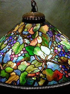 The large Tiffany shade designs are masterpieces of century decorative arts design. Always impressive, these larger lamp designs are very adaptable for use as table lamps, chandeliers and floor lamps. Stained Glass Lamp Shades, Stained Glass Rose, Tiffany Stained Glass, Stained Glass Windows, Tiffany Glass, Antique Lamps, Vintage Lamps, Tiffany Art, Large Lamps