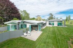 Secluded on of prime flat land and only minutes from the city fringe is this timeless contemporary home. The Dick Mercer design has been.