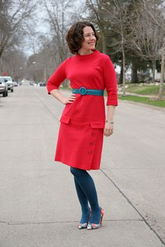 Love the deep-bright tights, similar belt, and colorful pumps with this red dress.