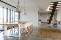 Buy Domestic open space by bialasiewicz on PhotoDune. Domestic open space with dining table and wooden stairs Interior Design Magazine, Interior Photo, Minimalist Architecture, Light Architecture, Minimalist Bedroom, Minimalist Design, Wallpaper Manufacturers, Green Duvet Covers, Light Building