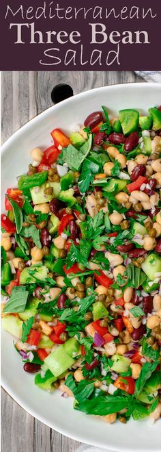 Mediterranean Three Bean Salad | The Mediterranean Dish. Three bean salad with chopped veggies, capers, fresh herbs and a zesty Mediterranean garlic Dijon vinaigrette. Best bean salad; the perfect potluck salad or healthy side dish. See it on TheMediterraneanDish.com