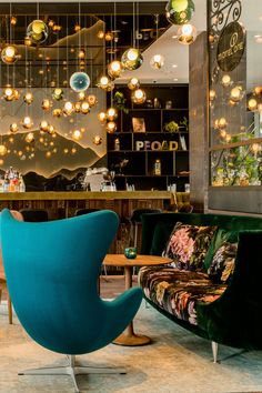 Hotel Salzburg-Sued Motel One with best price guarantee, free Wi-fi, free cancelation - modern and cheap budget design hotel Vienna located near the central station and the airport Salzburg, Motel One, Reception Areas, Design Hotel, Egg Chair, One Design, Alps, Beautiful Places, Plates
