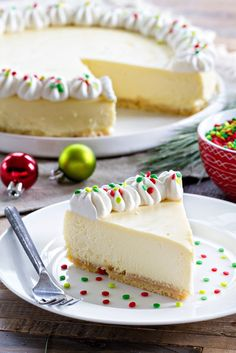 Sugar Cookie Cheesecake is sweet, creamy and deliciously festive for the holidays! A must-make!