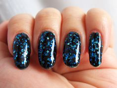 Nail Pattern Boldness I Believe I Can Fly - a dark blue jelly with silver square glitter and small red glitter. Click the image for more!