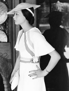 Anna May Wong shopping in Chinatown, Los Angeles, 1934 asian movie star 30s vintage fashion style day dress hat white stripe tilt flutter purse