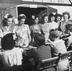 Women signing in to visit soldiers at a Servicemen's Country Club, Chicago, 1943.