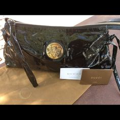 Gucci Black Patent Leather Hysteria Clutch Pleated detailing, bows on either side , gold hysteria logo on front, full zipper closure, black logo nylon leather interior, pristine condition Gucci Bags